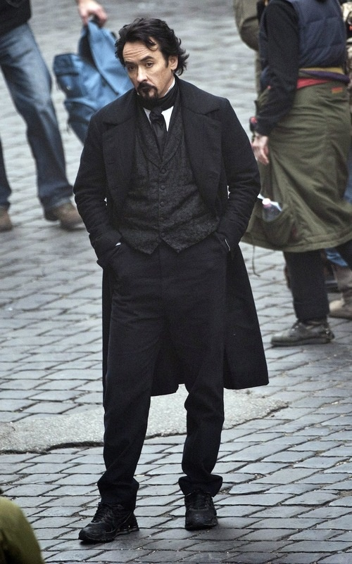 Cusack as Poe