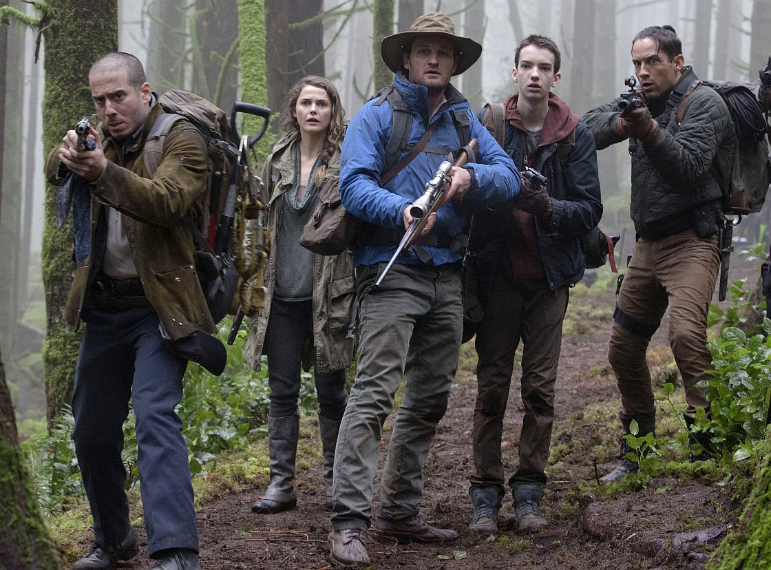 """Kirk Acevedo, Keri Russell, Jason Clarke, Kodi Smit-McPhee and Enrique Murciano in a scene from the motion picture """"Dawn of the Planet of the Apes.""""  CREDIT: David James, 20th Century Fox"""