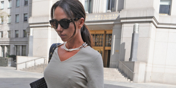 Molly Bloom exits Manhattan federal court, Friday, April 19, 2013, in New York. Nearly three dozen people were charged on Tuesday in what investigators said was a Russian organized crime operation that included illegal, high-stakes poker games for the rich and famous and threats of violence to make sure customers paid their debts. (AP Photo/ Louis Lanzano)